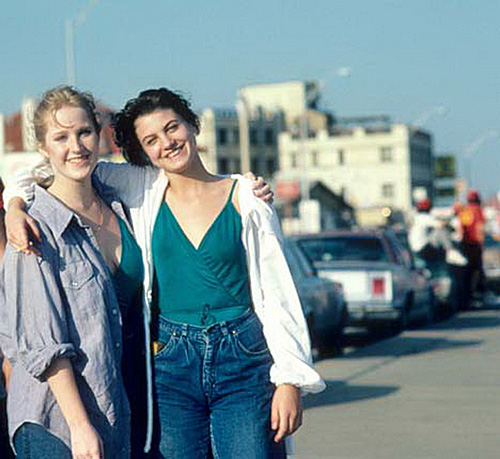 Two girls posing in bluejeans and green blouses, 1980