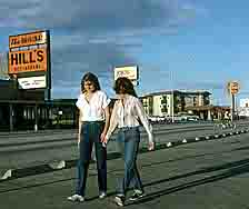 Two young women stroll by Hills Restaurant