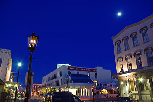 Moonlight and gaslight shine on Galveston's Strand