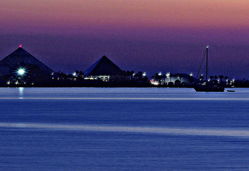 Moody Gardens viewed across the water at twilight